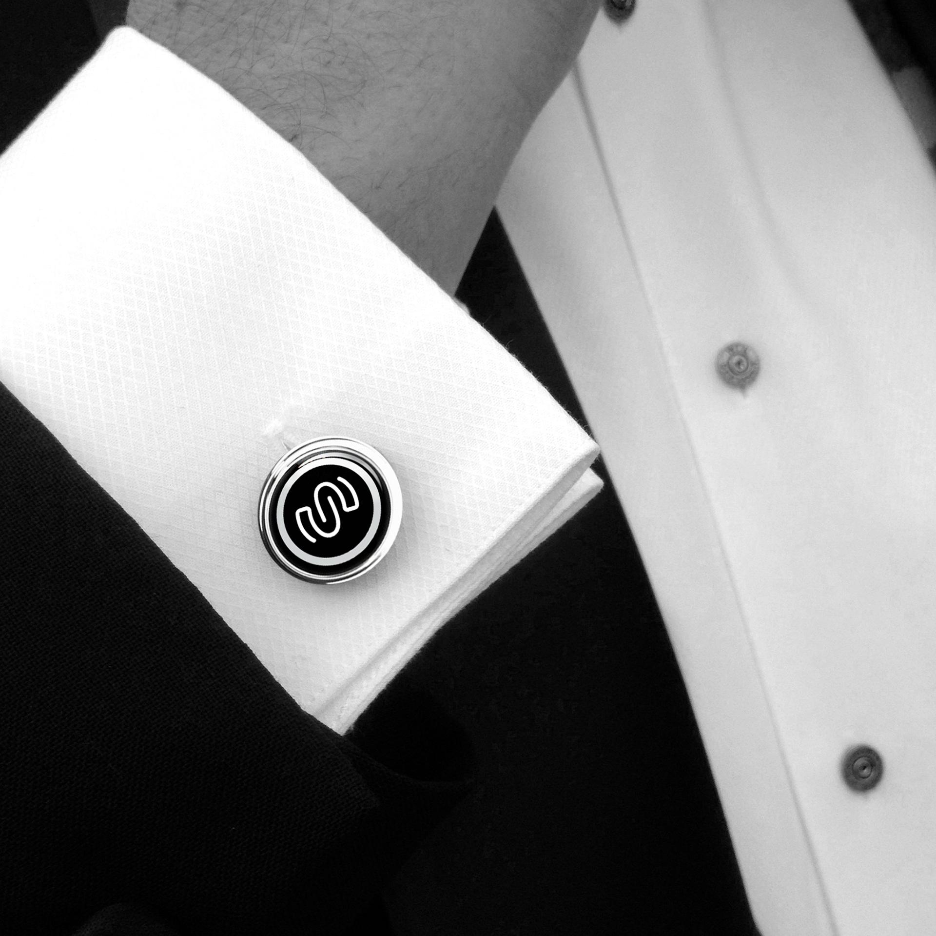 Seneworth - Close up on person wearing branded cufflinks