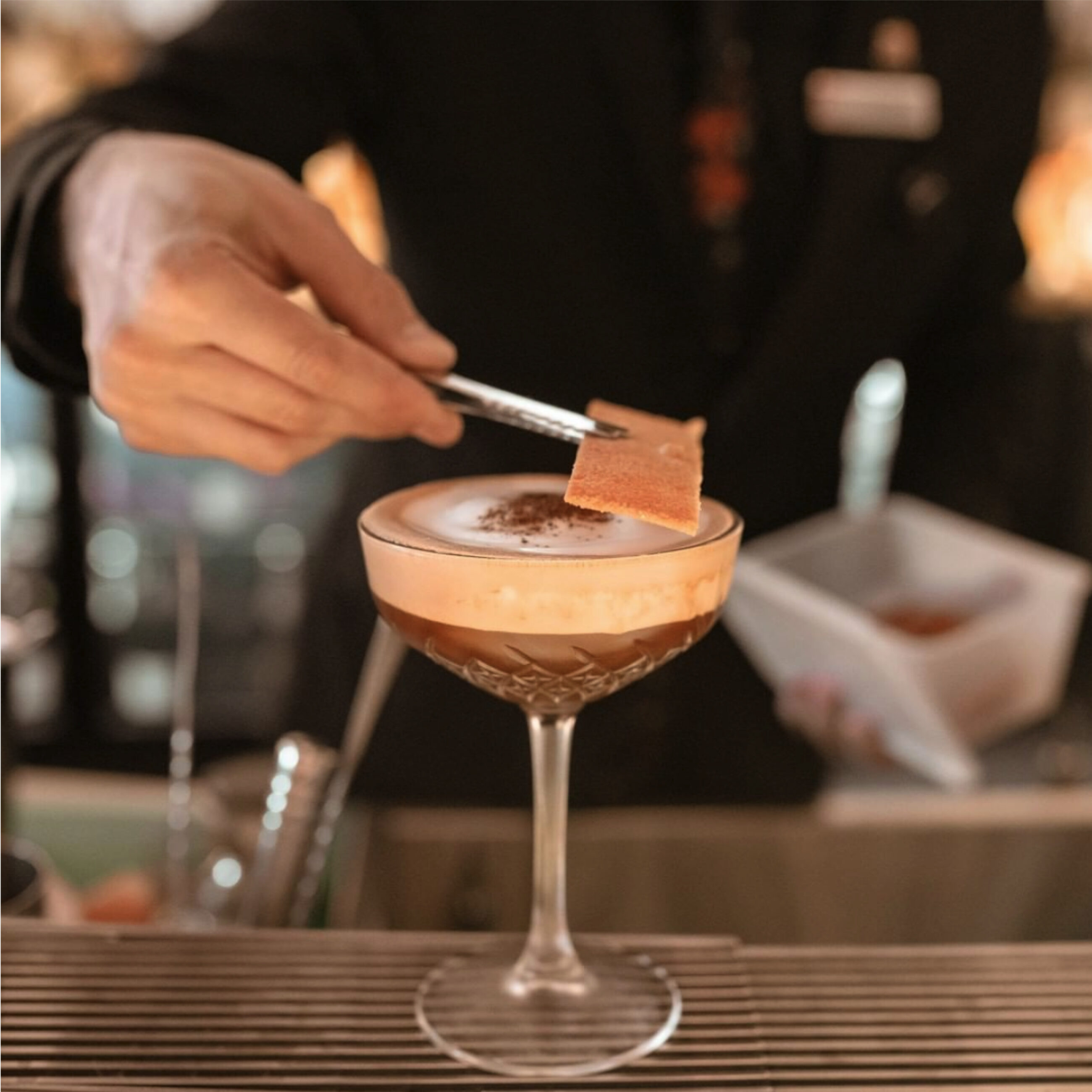 Close up of someone making a cocktail