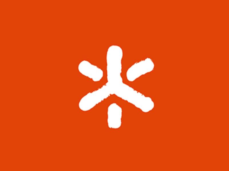 White asterisk on orange background