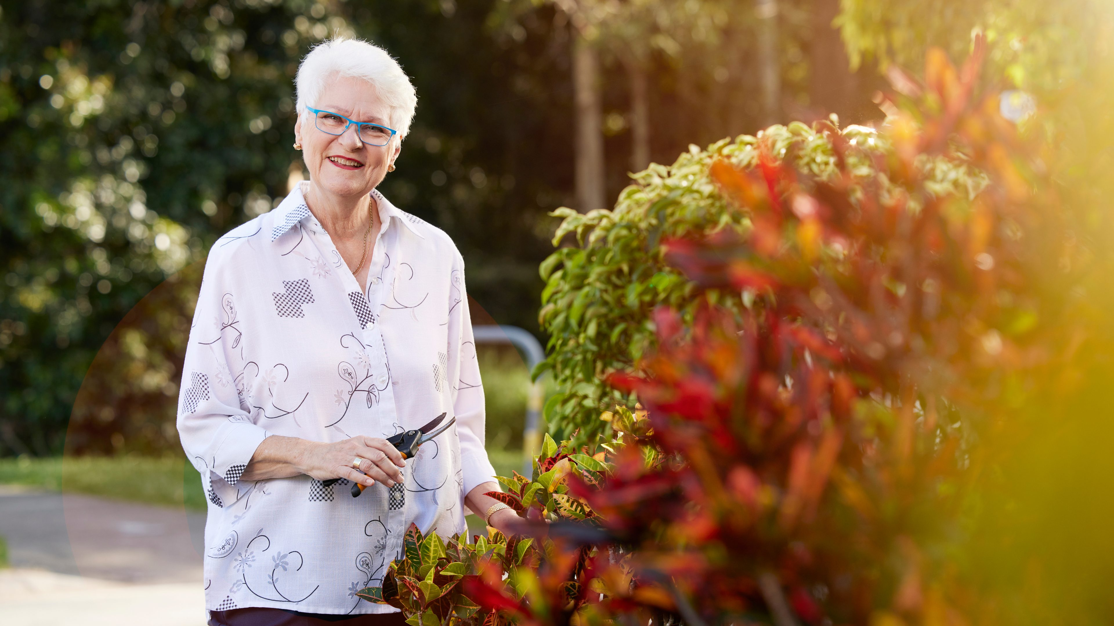 Older woman feeling relaxed and happy as her finances are all sorted by Cosca