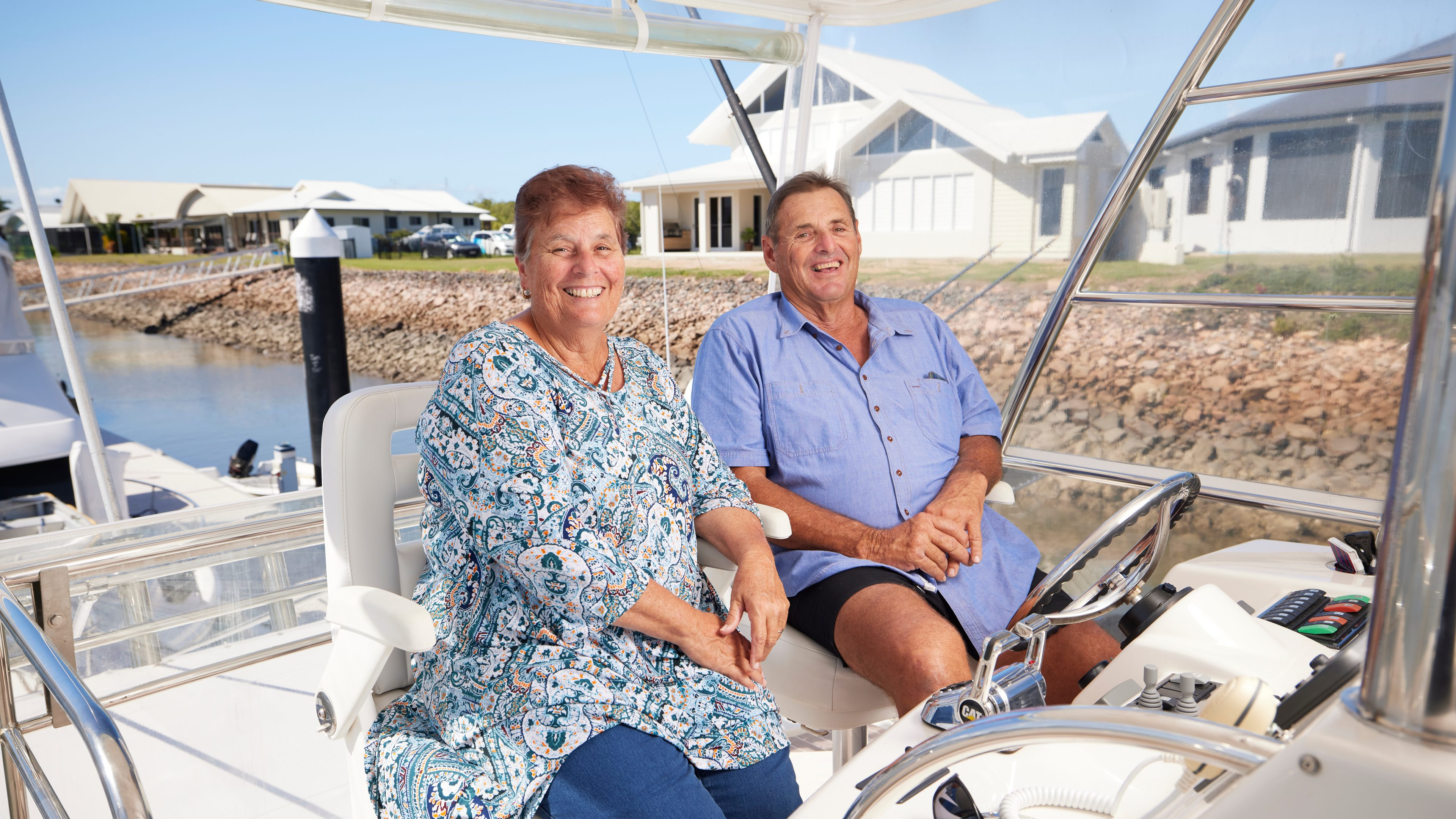 Photography of retired couple on a boat enjoying their financial freedom